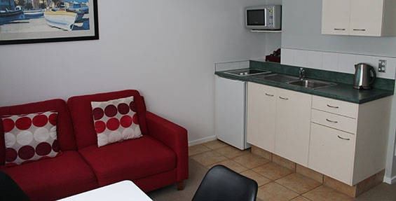 kitchen with cooktops, microwave and fridge