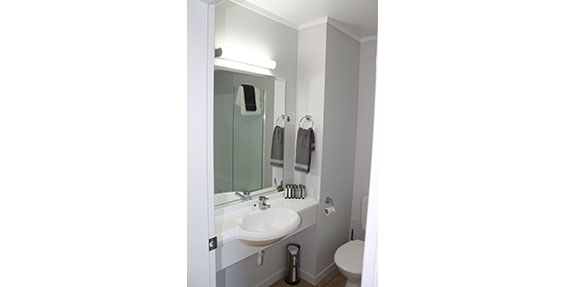 clean bathroom with a range of toiletries for guests use