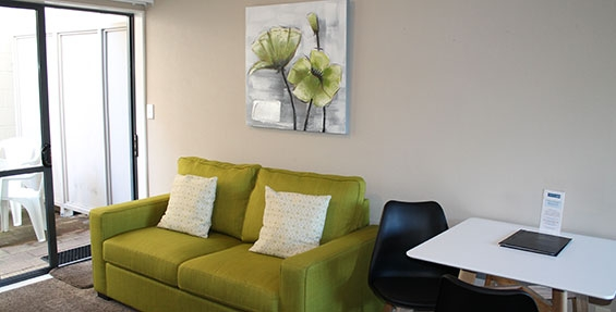 two-seater comfortable sofa and dining table available in one-bedroom suite