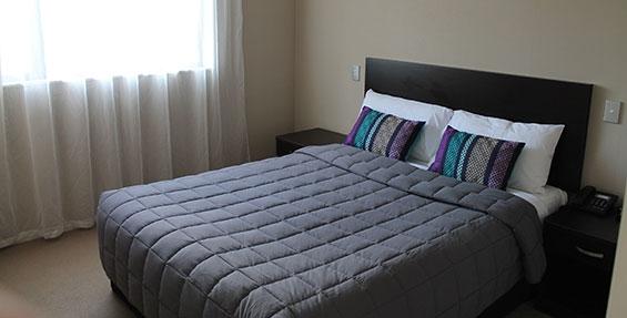 main bedroom of two-bedroom suite