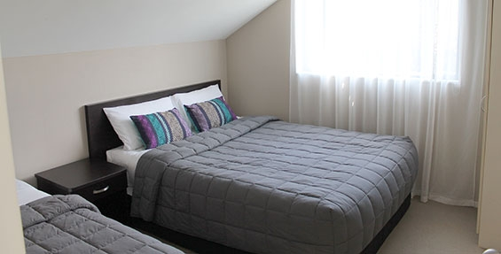 second room of two-bedroom suite has either two singles or one queen and one single beds
