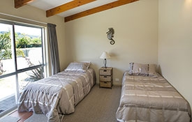 main bedroom has a king-size bed and second bedroom has 2 singles