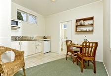 each unit has its own full kitchen with dining and a bathroom