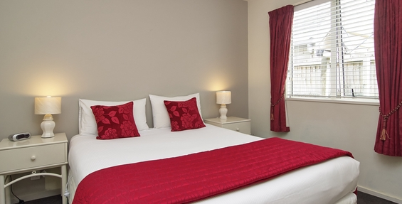 comfortable queen size bed and single beds in the unit