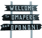 Image of a sign post saying Welcome to Opononi and Omapere