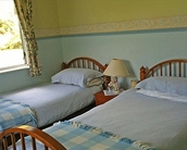 stylish and comfortable queen size bed in 1st bedroom and and twin beds in 2nd room