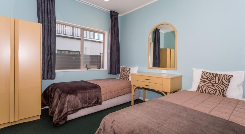 two single beds in a bedroom of 2-bedroom unit