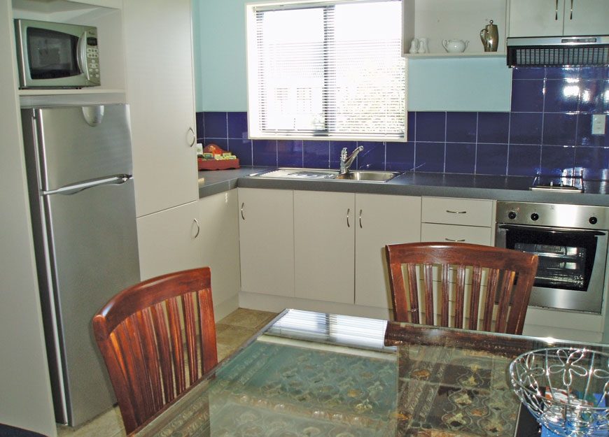 fully-equipped kitchen with dining table