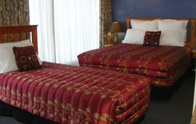 Unit Seven has a queen bed and two single beds