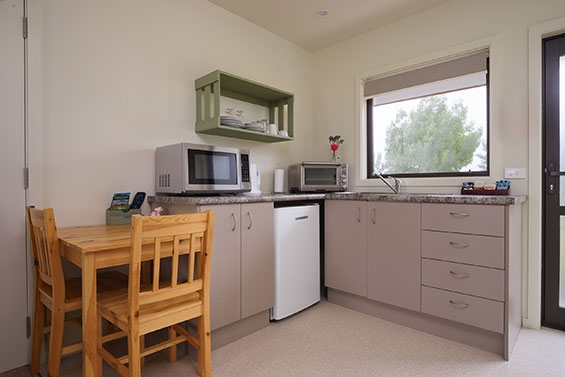 kitchenette with microwave and oven