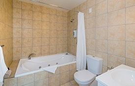 ensuite bathroom with spa bath and shower