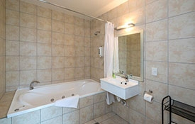 spa bath and shower in ensuite bathroom