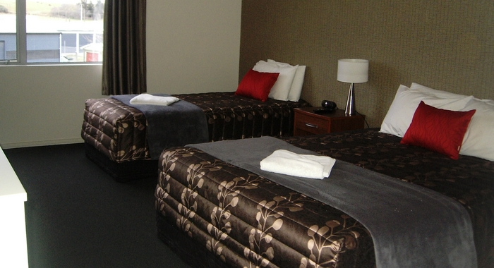 Queen-size and single beds in studio rooms