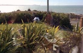 living area offers beautiful sea and bush views
