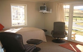 The lounge has one king-size single bed - Large Sized Cottage