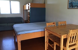 a double bed and four set of bunk beds in the cabin
