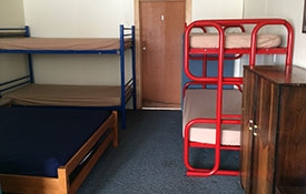 a double bed and 2 sets of bunks in the Bach