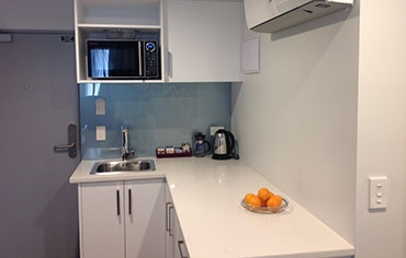 fully self-contained kitchens in all units