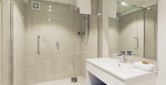fully tiled larger than normal bathroom