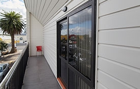 sliding doors open onto a balcony