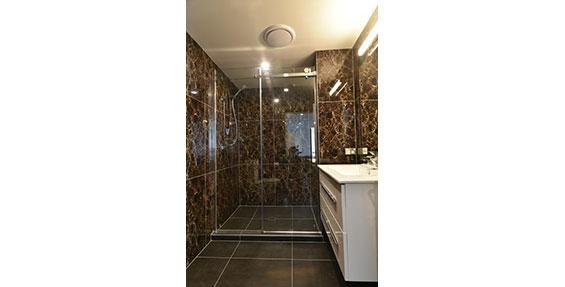 luxury fully tiled bathroom of one-bedroom suite