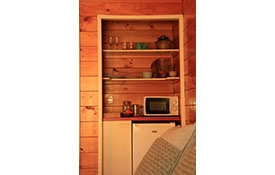 a small kitchenette in the room with microwave, fridge and tea/coffee making facilities