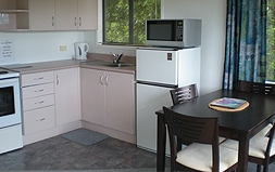 well-equipped kitchen and dining table