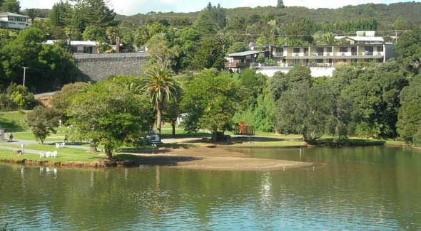 Image of the private beach and Waterfront Campground with Falls Motel in the background taken from the Waitangi Lagoon