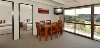 Image of a motel suite at Falls Motel in Paihia with views of Haruru Falls and Waitangi Lagoon